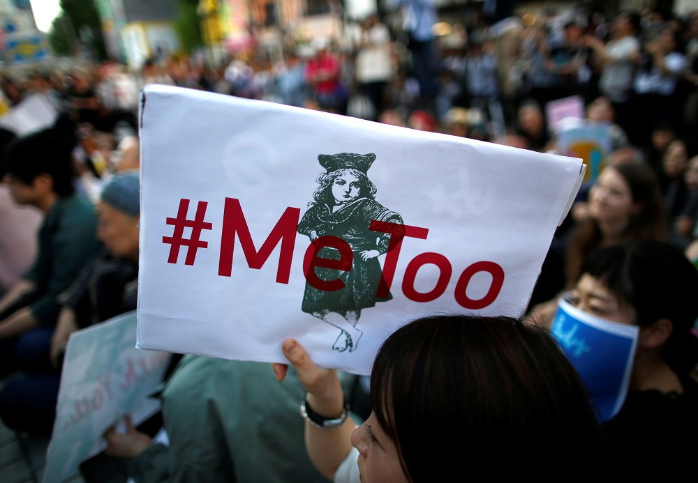 A protester raises a placard reading '#MeToo' during a rally against harassment at Shinjuku shopping and amusement district in Tokyo, Japan April 28, 2018. — Reuters pic