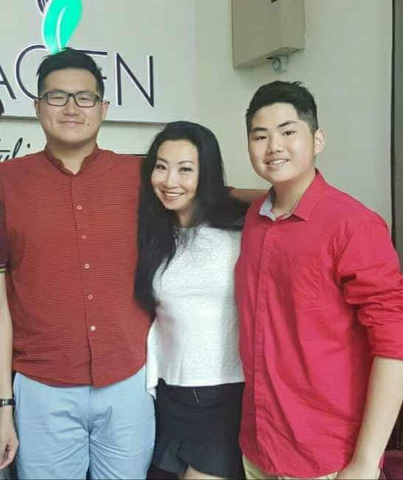 Florence with sons, Zenvern (left) and Brandon Tan.