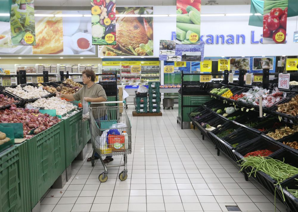 A woman shops for vegetables at a supermarket in Puchong. The government is implementing SST to replace the GST, which was repealed last June 1, to ease the people's burden.― Picture by Zuraneeza Zulkifli
