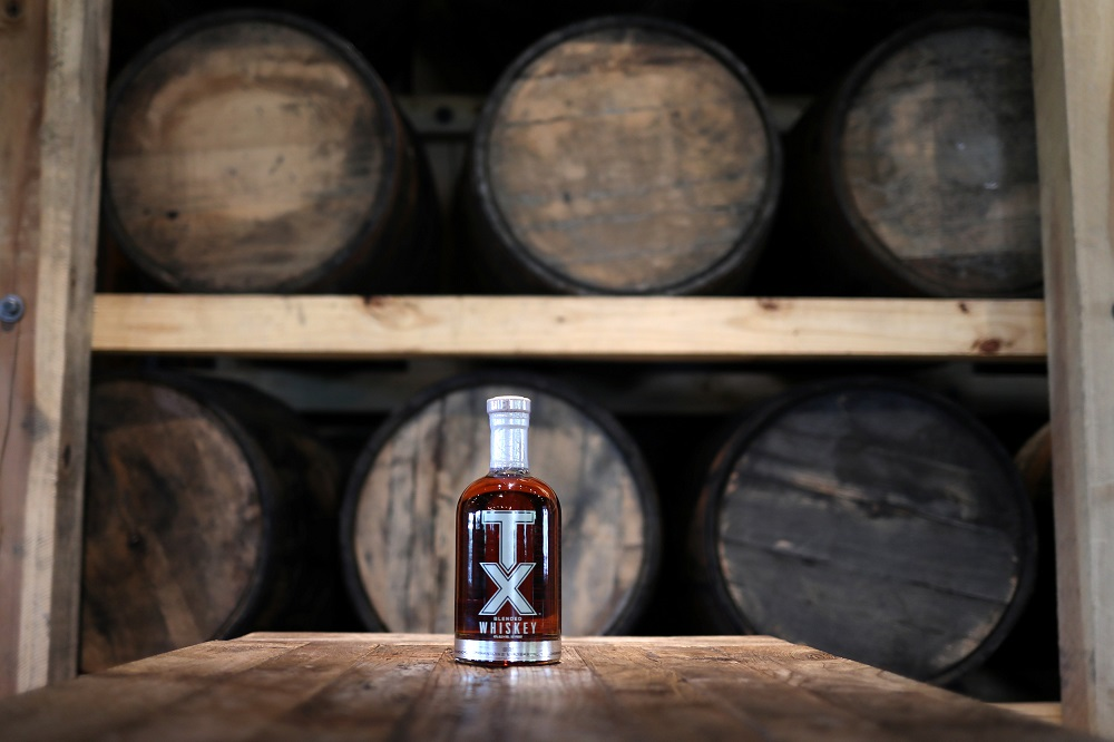 A bottle of TX Whiskey is photographed in the TX Tavern at the Firestone & Robertson (F&R) Whiskey Ranch in Forth Worth, Texas May 24, 2018.