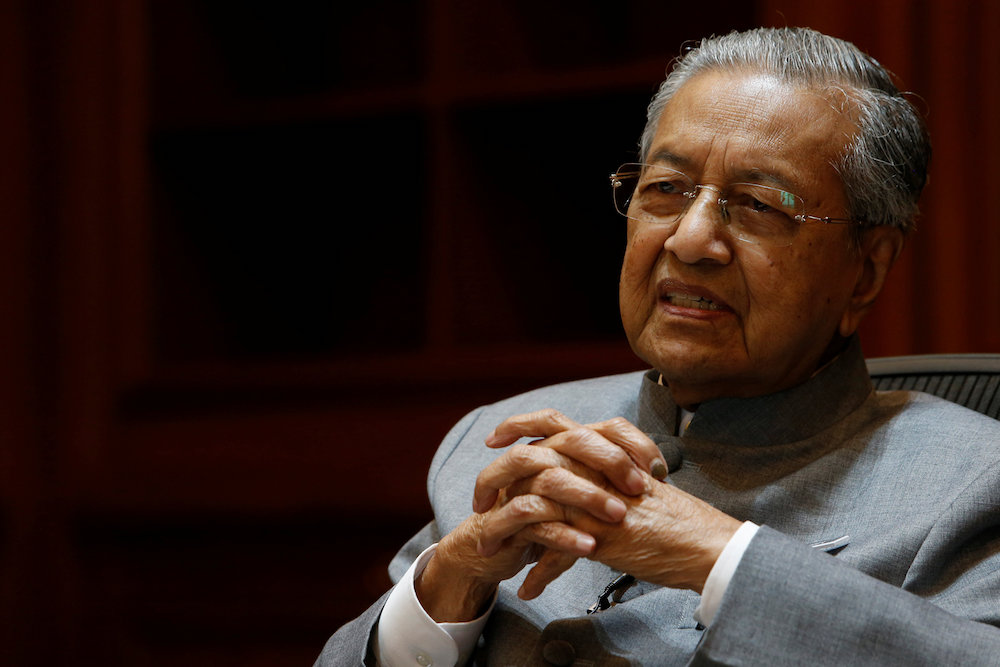 Prime Minister Tun Dr Mahathir Dr Mahathir said that Anwar was as free to speak about public matters as the rest of the country. — Reuters pic