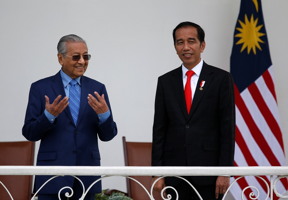 Prime Minister Tun Dr Mahathir Mohamad and Indonesian President Joko Widodo chat while on the balcony at the presidential palace in Bogor, south of Jakarta June 29, 2018. — Reuters pic