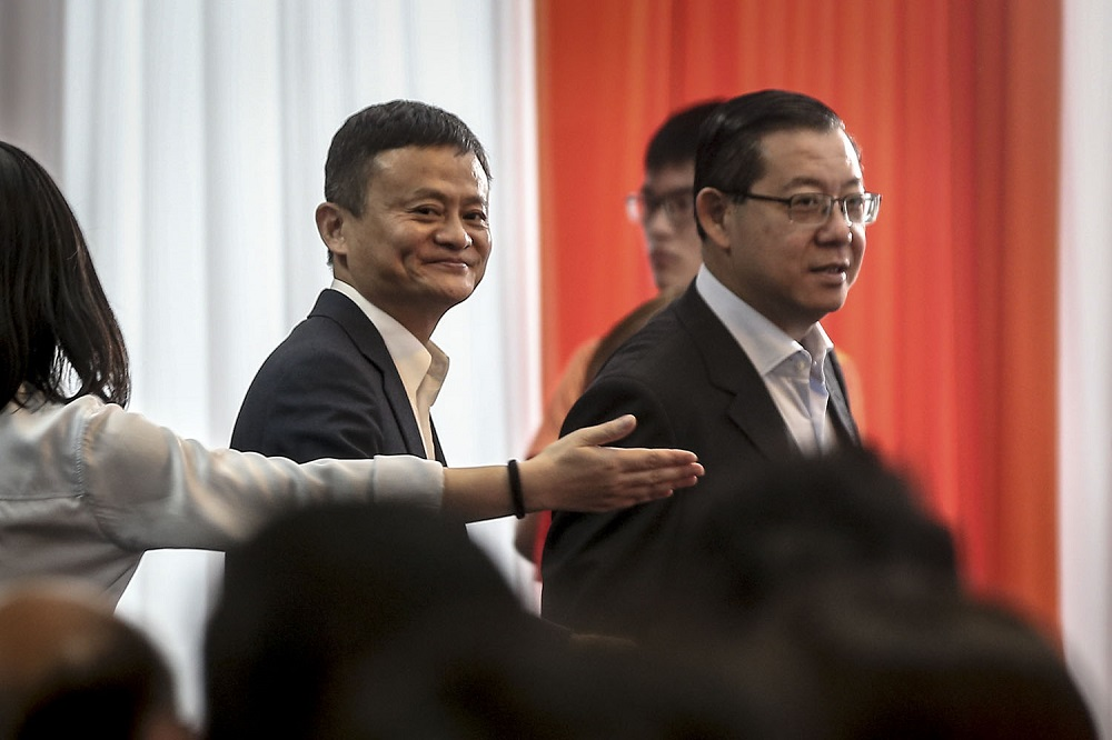 Alibaba Group executive chairman Jack Ma and Finance Minister Lim Guan Eng at the opening of the group's first South-east Asian office in Bangsar South, Kuala Lumpur June 18, 2018. — Picture by Hari Anggara