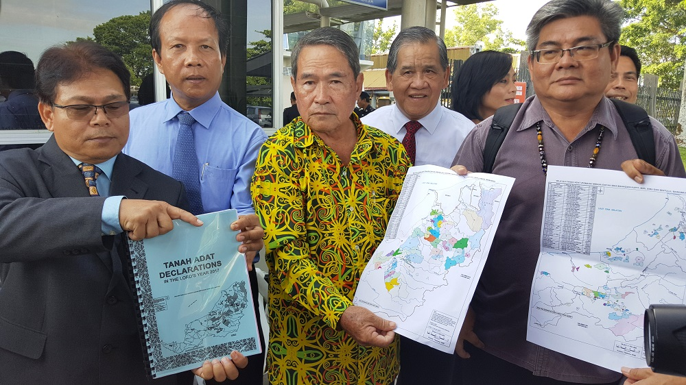 SCRIPTS chairman Michael Jok (right) and legal adviser Henry Joseph (left) after handing over the Native Customary Rights Land Declaration to the deputy chief minister's office in Kuching June 22, 2018. — Picture by Sulok Tawie