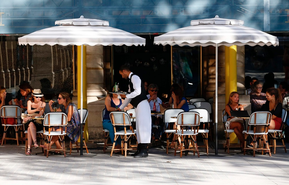In the capital Paris, where the risk of coronavirus spread remains higher than in the rest of the mainland, only the outside terraces of eating and drinking establishments can reopen to clients. — AFP pic