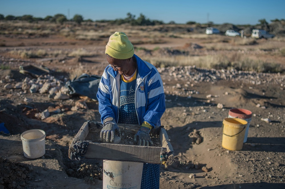 Clara Maitse, 77, a former illegal miner, filters dirt and soil as she searches for minerals following the legalisation of mining in limited areas on June 5, 2018 in Kimberly, Northern Cape, South Africa. — AFP pic