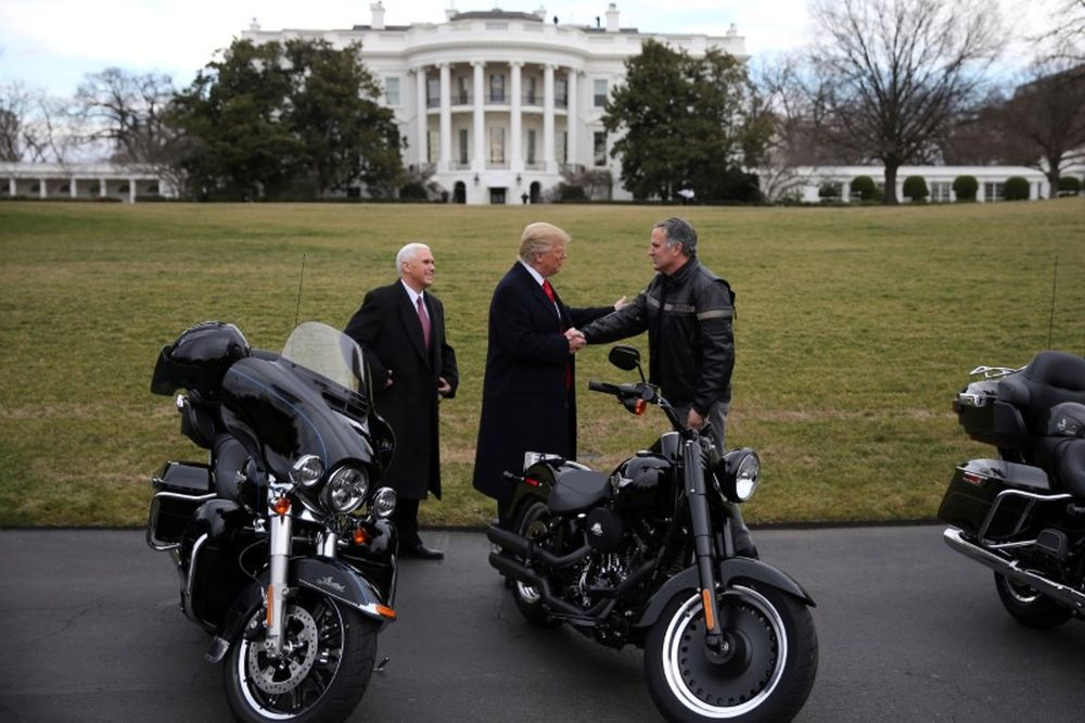 US President Donald Trump shakes hands with Matt Levatich, CEO of Harley Davidson, accompanied by Vice President Mike Pence, during a visit of the company's executives at the White House in Washington February 2, 2017. ― Reuters pic