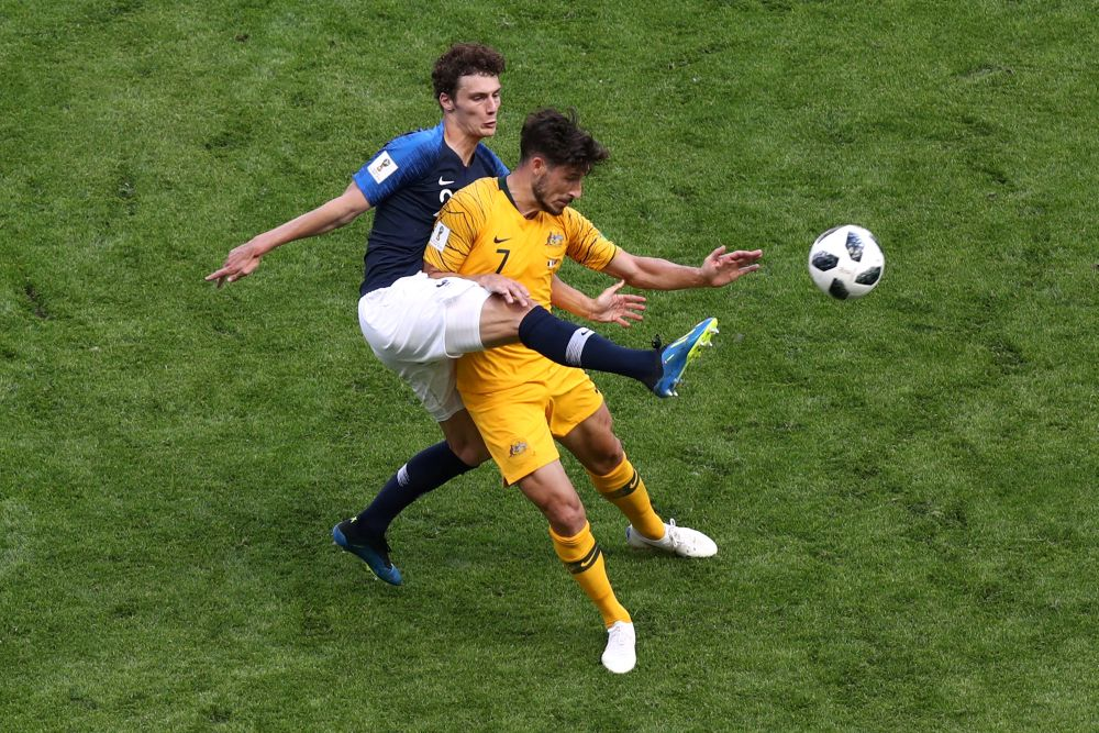 France's Benjamin Pavard in action with Australia's Mathew Leckie. — Reuters pic
