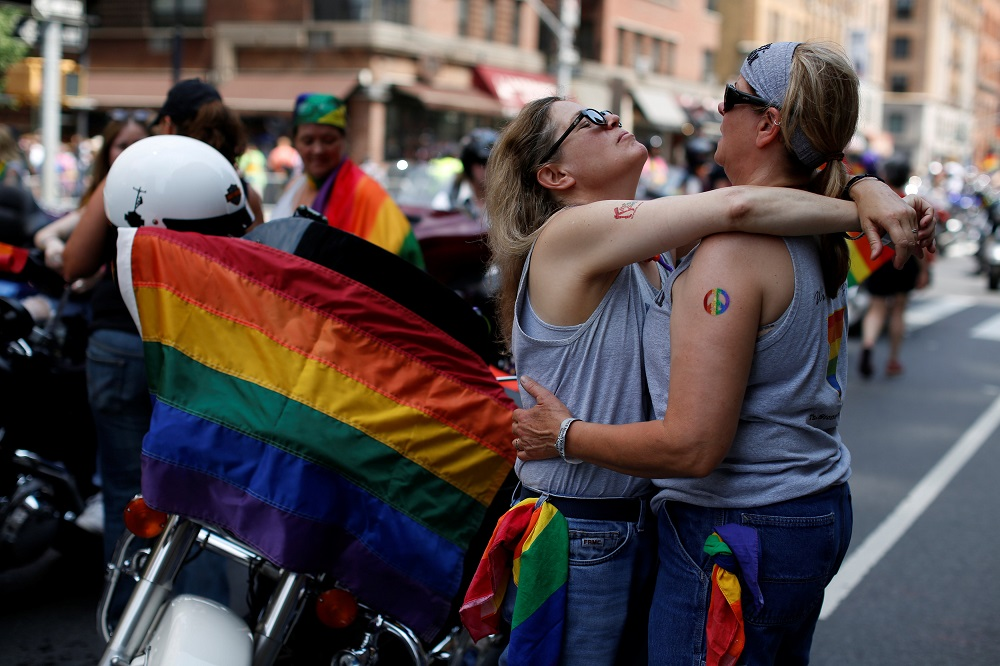 Deborah Spell and her wife Wendy Kennedy embrace before the 2018 New York City Pride Parade in Manhattan, New York, June 24, 2018.