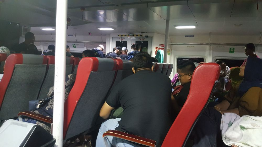 Passengers in the ferry which was stranded for more than six hours at a sandbar at the Kuala Perlis estuary. ― Picture via Facebook/Poh Choong