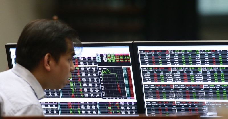 A stockbroker looks on his monitors inside the Philippine Stock Exchange (PSE) in Makati city, Manila February 29, 2016. — Reuters pic