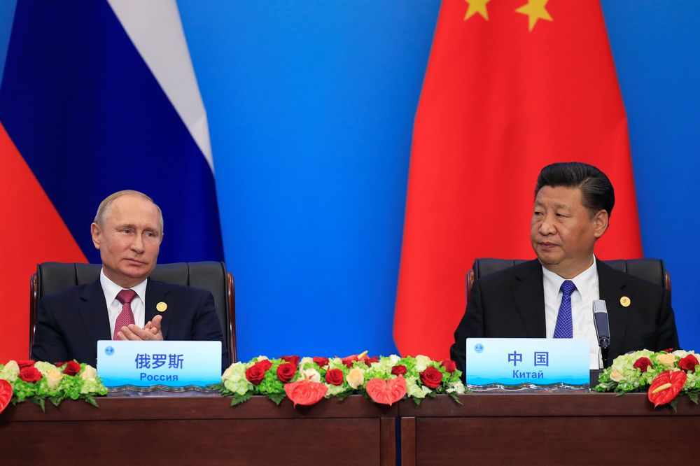 China's President Xi Jinping and Russia's President Vladimir Putin attend a signing ceremony during Shanghai Cooperation Organisation (SCO) summit in Qingdao, Shandong Province, China June 10, 2018. — Reuters pic