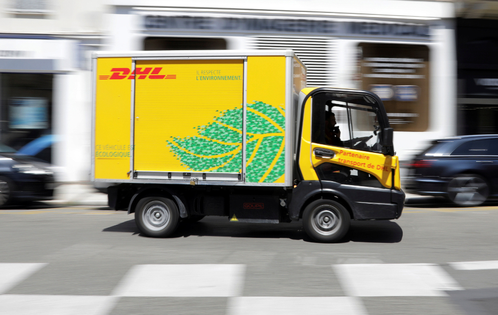 A DHL delivery van drives along a street in Nice June 5, 2018. — Reuters pic
