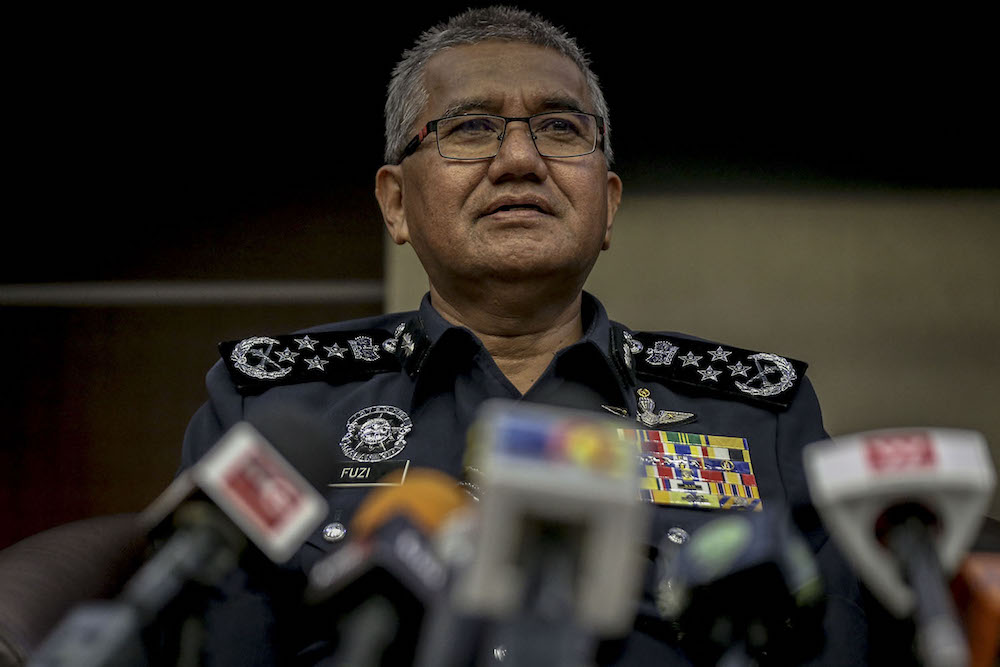 Inspector General of Police Tan Sri Mohamad Fuzi Harun said Unity and Social Wellbeing Minister P. Waytha Moorthy will be investigated either under the Penal Code or the Sedition Act 1948 for remarks purportedly made after riots at a Hindu temple. — Picture by Hari Anggara