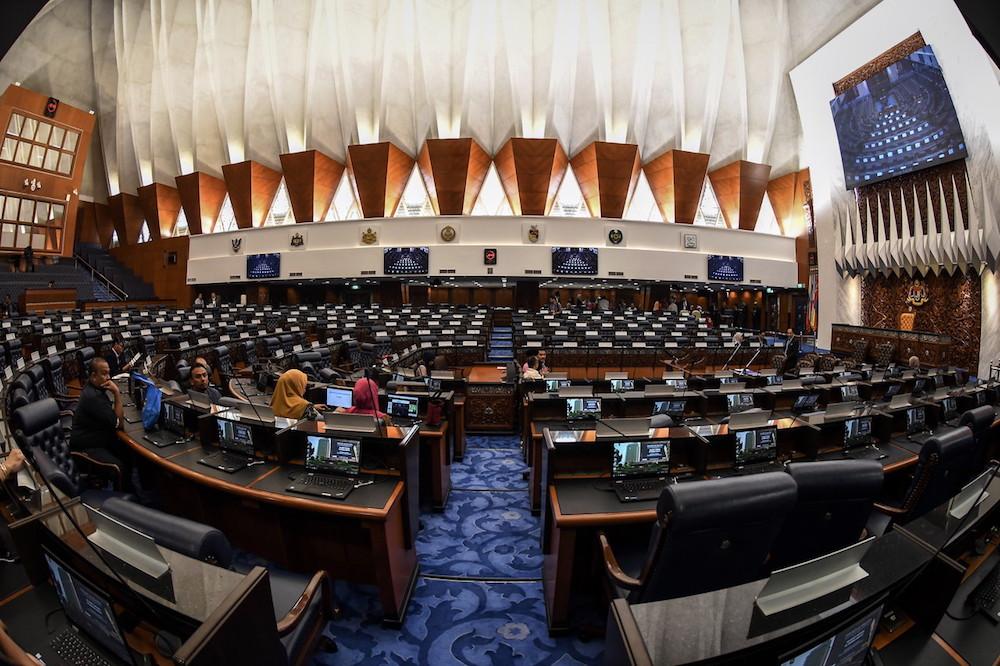 Parliament staff making last-minute preparations before Parliament convenes in this file picture. — Bernama pic