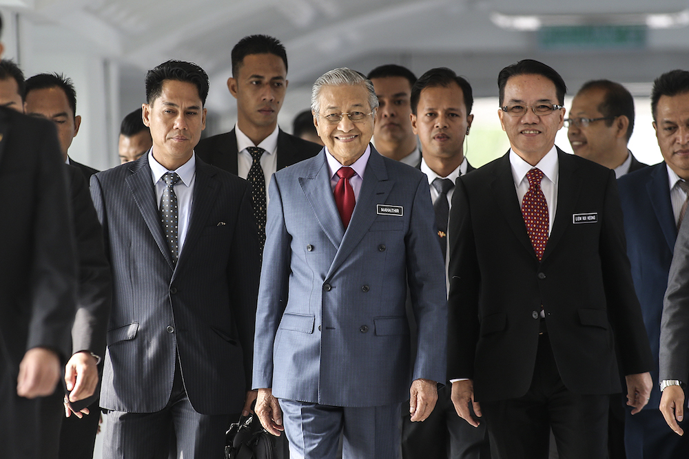 Prime Minister Tun Dr Mahathir Mohamad Ismail arrives for the 14th Parliament Session, July 16, 2018. — Picture by Azneal Ishak