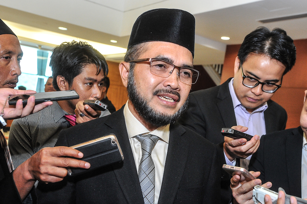 Three Sarawak DAP leaders today filed a police complaint against Pasir Puteh MP Nik Muhammad Zawawi Salleh (pic), asking for a police investigation into the latter for his distorted interpretation of the Bible during a debate in Parliament four days ago. — Picture by Shafwan Zaidon