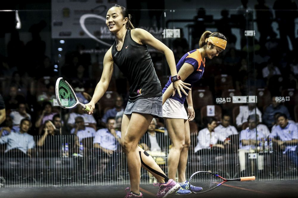Low Wee Wern (right) together with Satomi Watanabe (left) in action during the Malaysian Open squash championships at Bukit Jalil squash centre. — Picture by Hari Anggara.