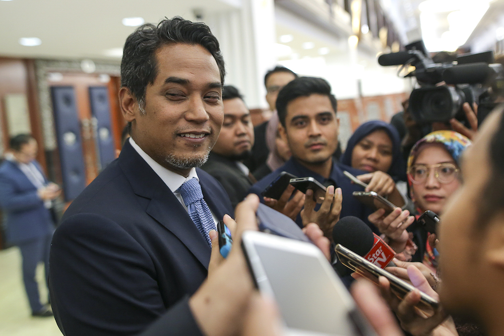 Khairy was in a jovial mood while attending Parliament today. — Picture by Azneal Ishak
