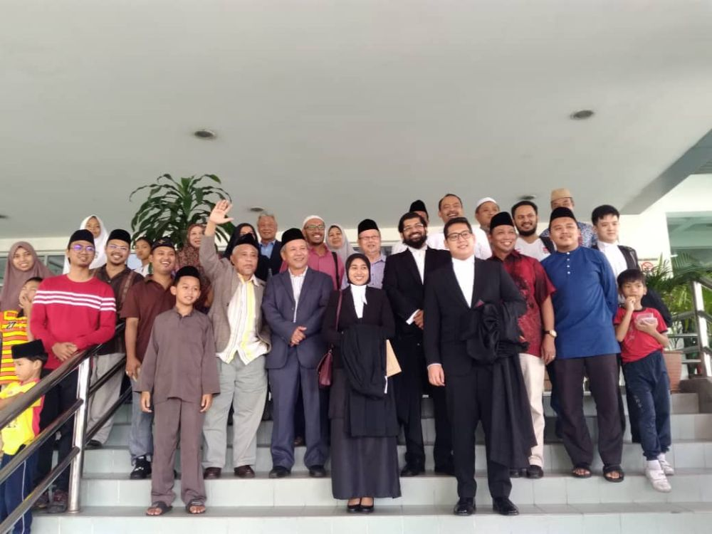 The Ahmadiyya community celebrates with their lawyers after the decision by the Shah Alam High Court today, July 6, 2018. ― Picture courtesy of Jemaat Ahmadiyyah
