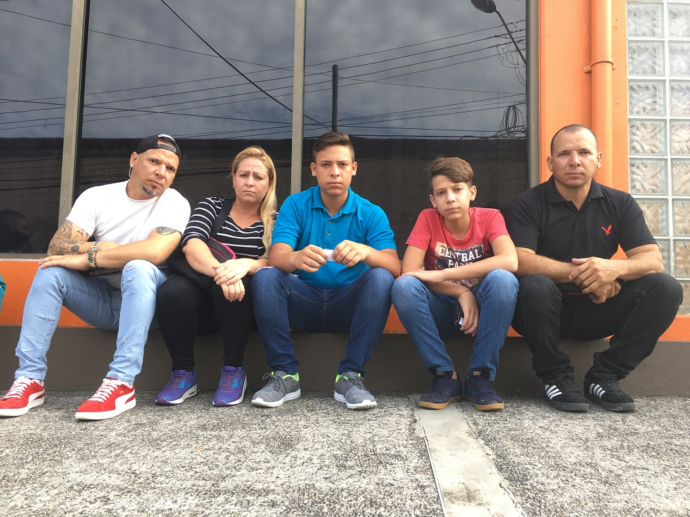 Venezuelan migrant Miguel Vegas (right) and his family pose for a portrait while they wait outside Living Waters Community, a processing centre for refugee and asylum applicants, in Port of Spain, Trinidad and Tobago May 23, 2018. — Thomson Reuters Foundation pic