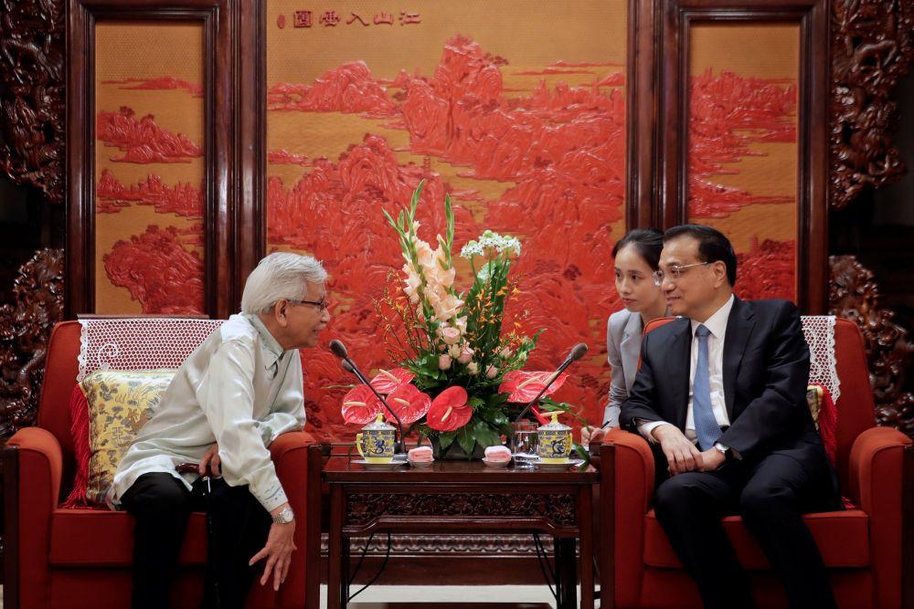 Tun Daim Zainuddin talks with Chinese Premier Li Keqiang during their meeting at the Zhongnanhai Leadership Compound in Beijing July 18, 2018. — Reuters pic