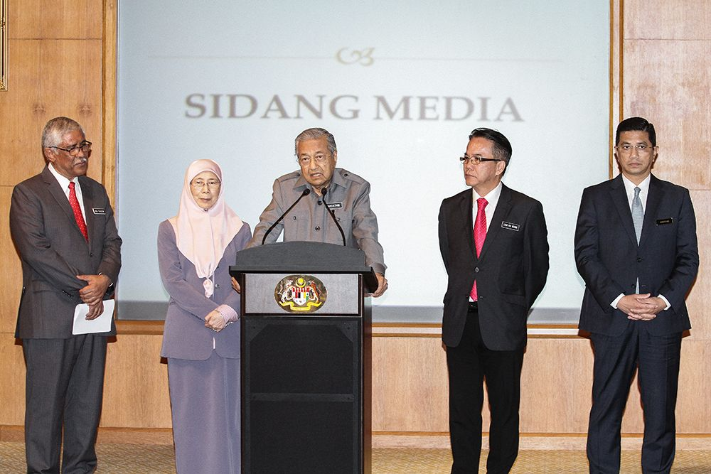 Tun Dr Mahathir Mohamad (centre) speaks during a press conference in Putrajaya July 9, 2018. — Picture by Miera Zulyana