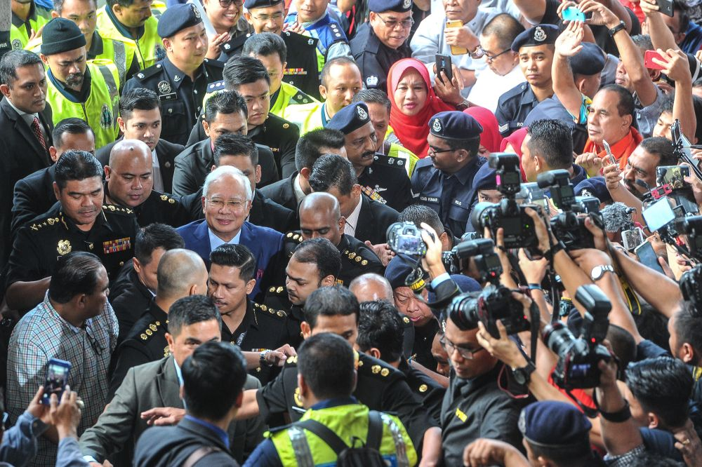 Datuk Seri Najib Razak arrives at the Kuala Lumpur High Court, July 4, 2018.  ― Picture by Shafwan Zaidon