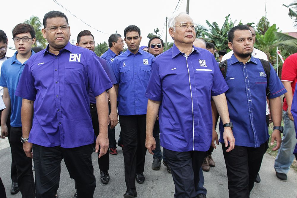 Datuk Seri Najib Razak is pictured on a walkabout with BN candidate Datuk Lokman Adam (front, left) in Sungai Kandis this morning. — Picture by Miera Zulyana