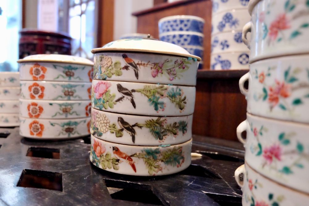 These are Pre-Peranakan era tingkats that we're used by large Chinese households to serve food to different quarters.