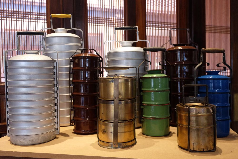 Metal tiffin carriers that were used including those used in India and those used by Chinese households but were made in Eastern Europe.