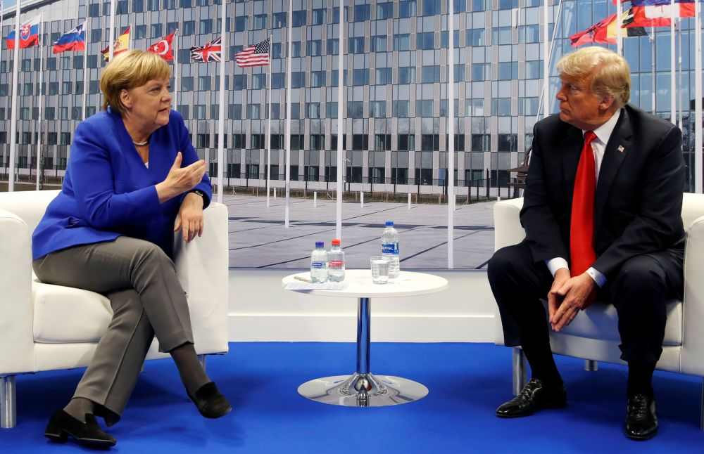 US President Donald Trump meets with German Chancellor Angela Merkel during the Nato summit in Brussels. —Reuters pic
