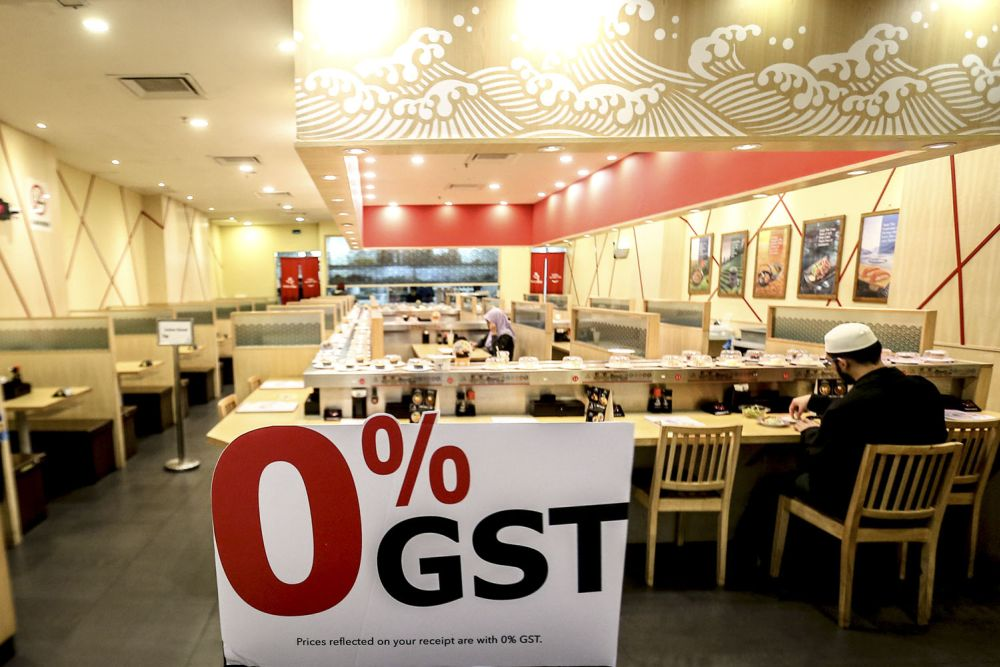 A sign displaying the zero-rated GST change is seen at a food outlet at Avenue K in Kuala Lumpur July 18, 2018. — Picture by Hari Anggara