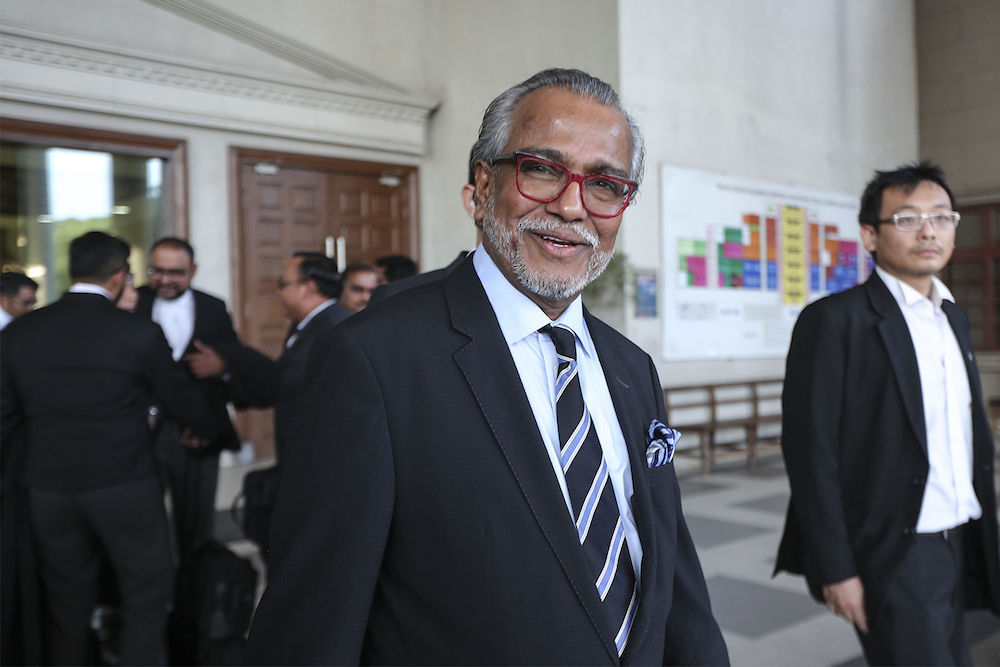 Lawyer Tan Sri Muhammad Shafee Abdullah leaves the High Court in Kuala Lumpur August 10, 2018. — Picture by Azneal Ishak