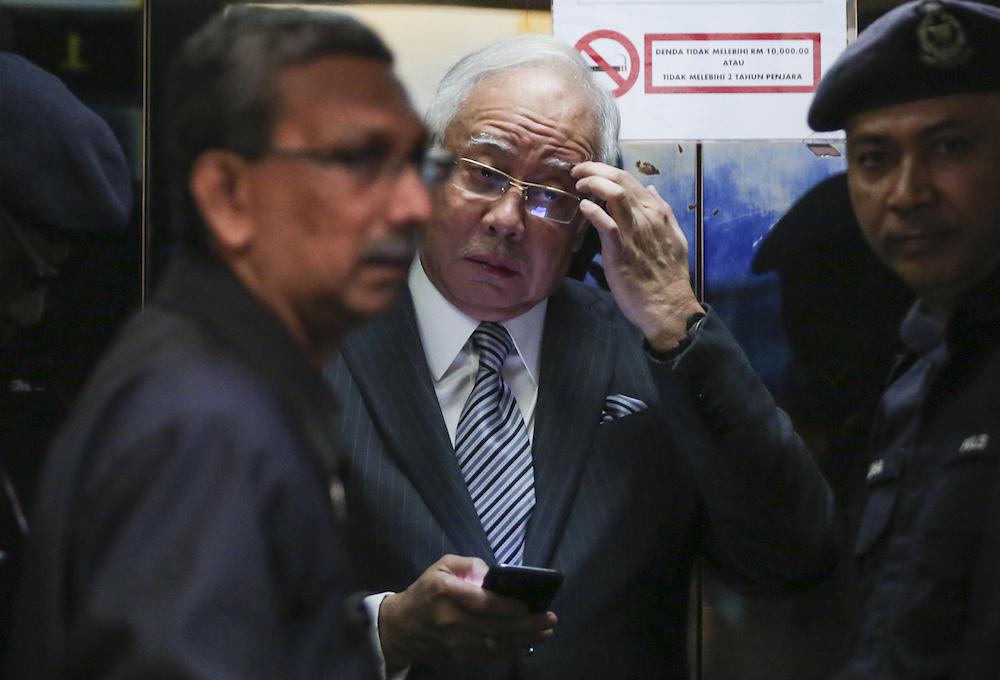 Datuk Seri Najib Razak arrives at the High Court in Kuala Lumpur August 10, 2018. — Picture by Azneal Ishak