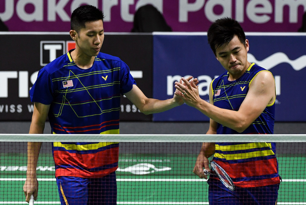 Goh V Shem and Tan Wee Kiong (pic) only took 40 minutes before defeating their compatriots Goh Sze Fei and Nur Izzuddin Mohd Rumsani; winning 21-16 and 21-19 in the quarter-finals match telecast live by a local private television station. — Bernama pic