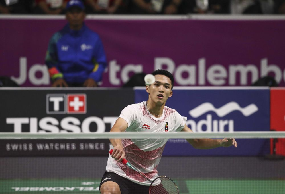 Jonatan Christie of Indonesia goes for a shot against Chou Tienchen of Taiwan in this file picture. ― Reuters pic