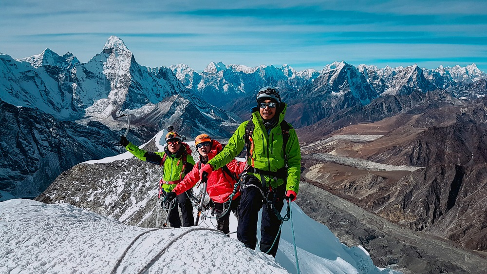 This handout photo released by the Hkakabo Razi Expedition 2018 on August 13, 2018 and taken on November 15, 2017 shows Myanmar mountaineers Aung Khaing Myint (right), Zaw Zin Khine (centre), and Pyae Phyo Aung during their ascent of Ama Dablam mountain in Nepal, in preparation for a mountaineering expedition to Hkakabo Razi on the northern tip of Myanmar near the border with China and India. — AFP pic