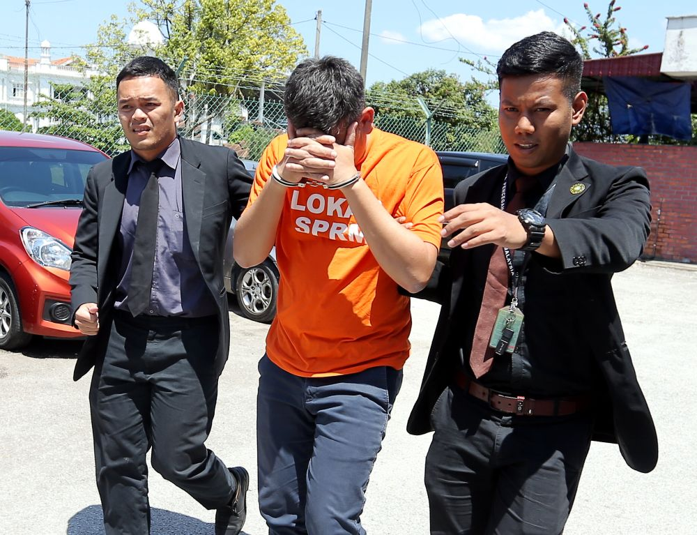 A former CEO of Amanjaya Career Centre was arrested by MACC at the commission's office here at 3.50am today, following a series of raids on several premises. ― Picture by Farhan Najib