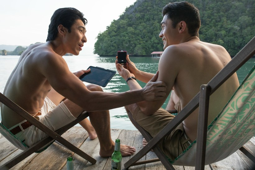 Nick and his friend Colin (played by Chris Pang) enjoy a bachelor party on the island. — Photo courtesy of Warner Bros