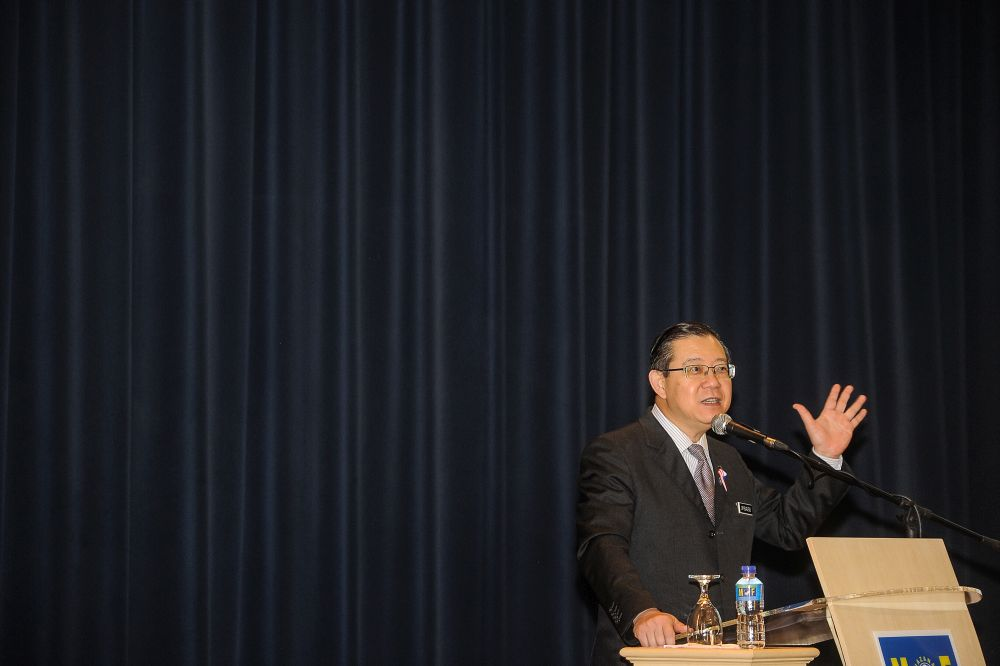 Finance Minister Lim Guan Eng says although sales tax has been fixed to be between 5 and 10 per cent and service tax at 6 per cent from September 1, the rate for goods and services may be lowered in future. — Picture by Shafwan Zaidon