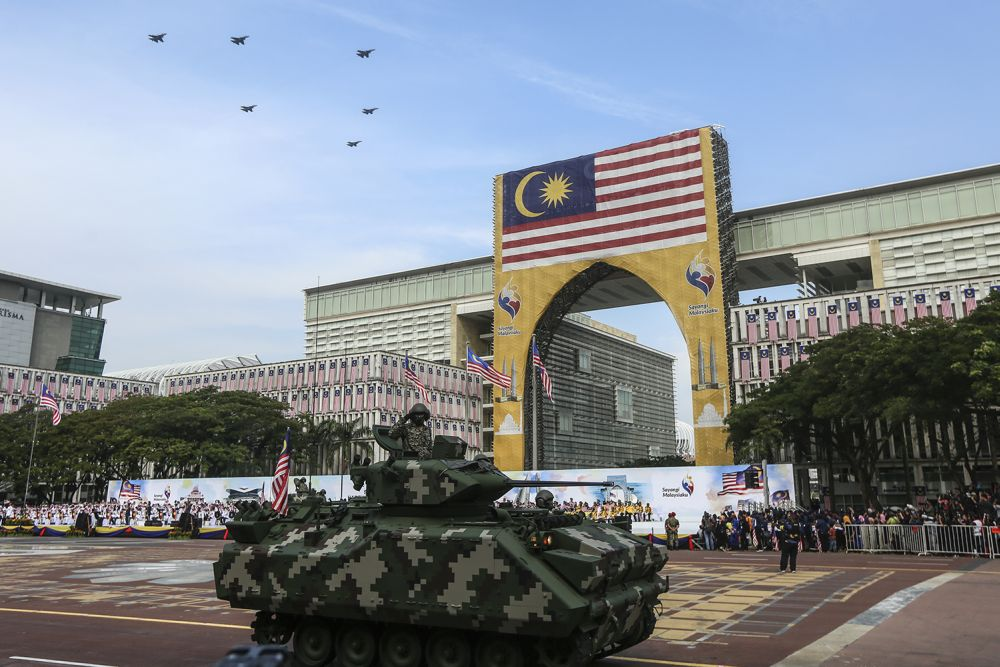 A Malaysian Armed Forces tank drives by during the National Day parade at Dataran Putrajaya August 31, 2018. — Picture by Azneal Ishak