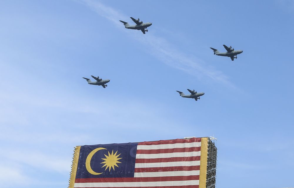 Royal Malaysian Air Force aircraft take to skies during the National Day parade at Dataran Putrajaya August 31, 2018. — Picture by Azneal Ishak