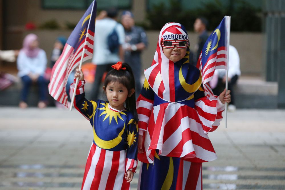 Children clad in the 'Jalur Gemilang' are pictured at Dataran Putrajaya August 31, 2018. — Picture by Azinuddin Ghazali