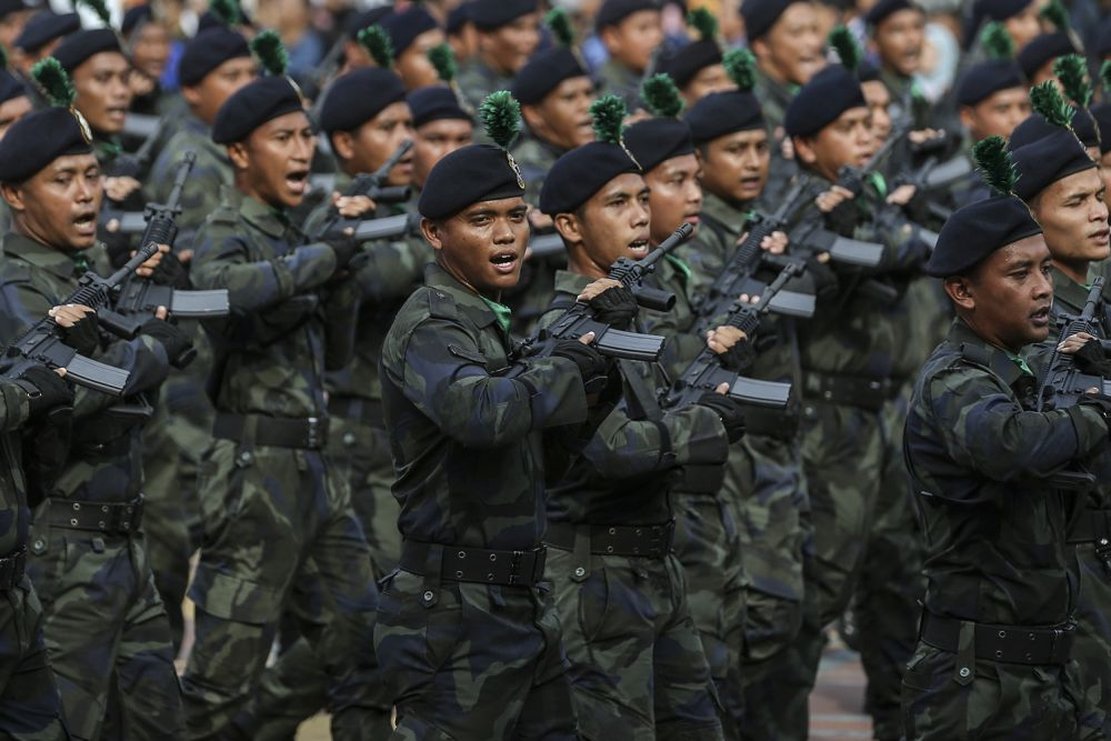 Malaysian Armed Forces march during the National Day parade at Dataran Putrajaya August 31, 2018. The Malaysian Armed Forces (MAF) veterans have voiced their intention to contest in the 15th General Election using their own political platform and targeting about 50 Parliamentary and State Legislative Assembly seats. — Picture by Azneal Ishak