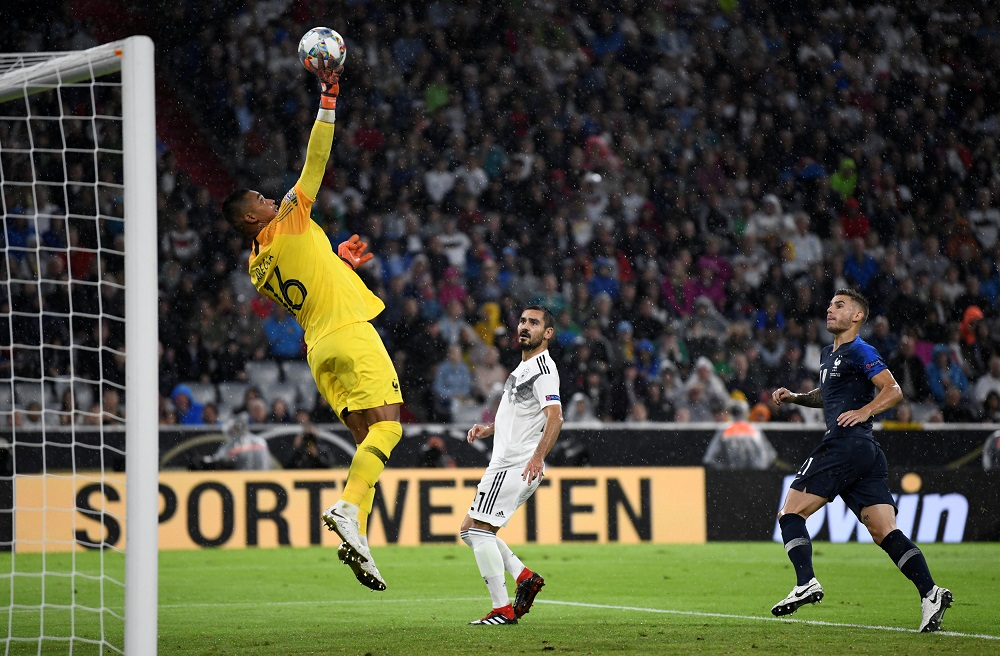 France's Alphonse Areola and Lucas Hernandez in action with Germany's Ilkay Gundogan during the Nations League match at the Allianz Arena in Munich September 6, 2018. — Reuters pic