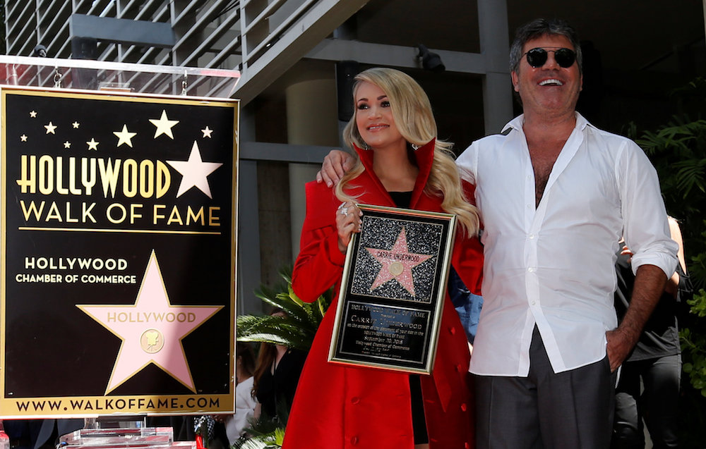 Carrie Underwood accompanied by Simon Cowell attends the unveiling of her star on the Hollywood Walk of Fame in Los Angeles September 20, 2018. — Reuters pic