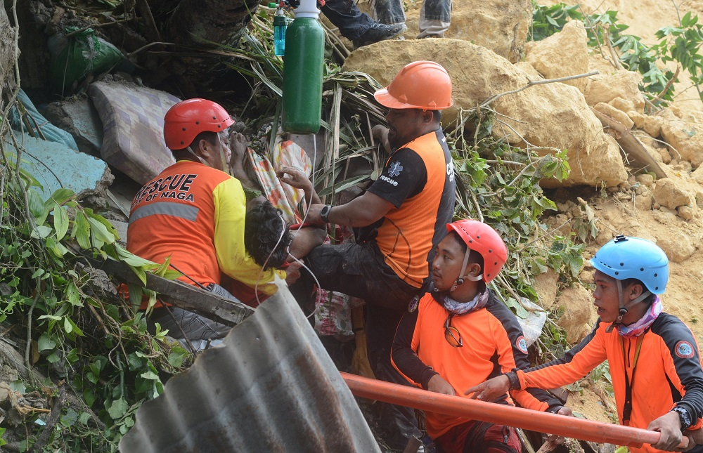 Rescuers pull out a survivor from rubble after a landslide in the City of Naga, Cebu, Philippines September 20, 2018. — Reuters pic