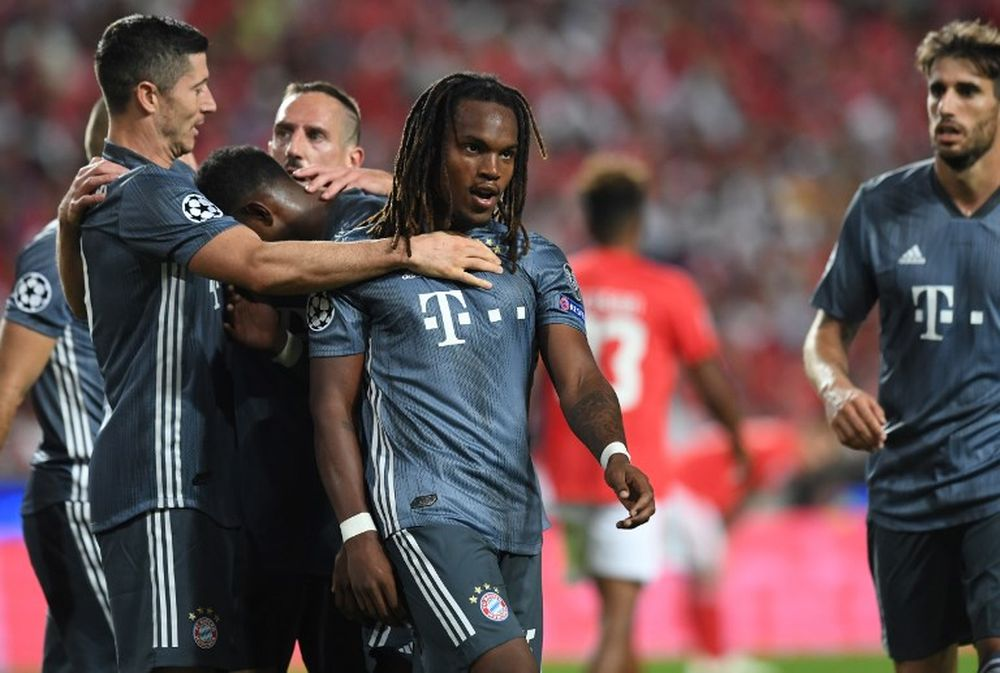 Bayern's Portuguese midfielder Renato Sanches (centre) celebrates after scoring a goal during the Uefa Champions League group E match Benfica v FC Bayern Munich in Lisbon, September 19, 2018. — AFP pic