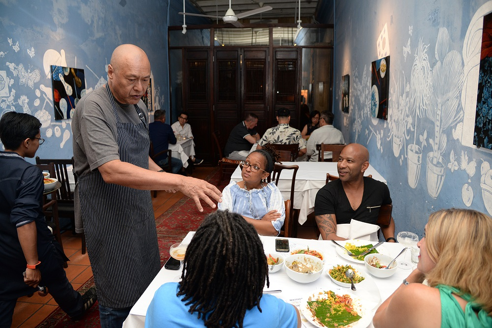 Chef Damian D'Silva talking to guests during the dinner he cooked at China House recently. — Picture by Steven Ooi K.E